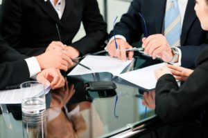 11840854 - business - meeting in an office; lawyers or attorneys discussing a document or contract agreement
